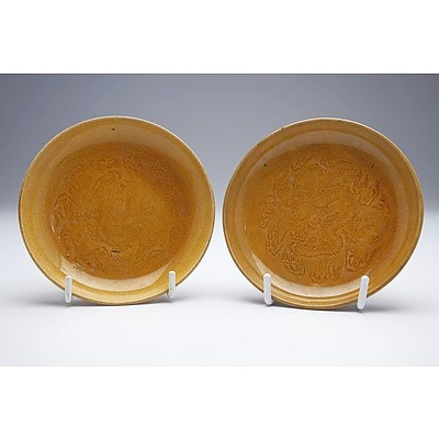 Pair of Chinese Soft Paste Yellow Glaze Saucer Dishes with Stamped Dragon Decoration, Late Qing