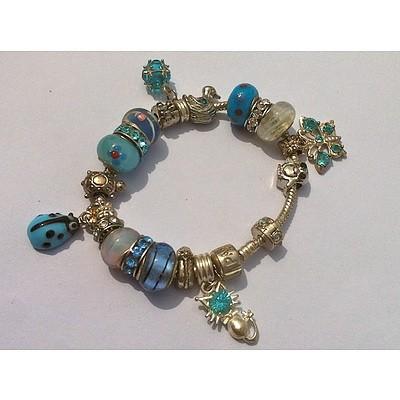 Blue/silver toned novelty charm bracelet