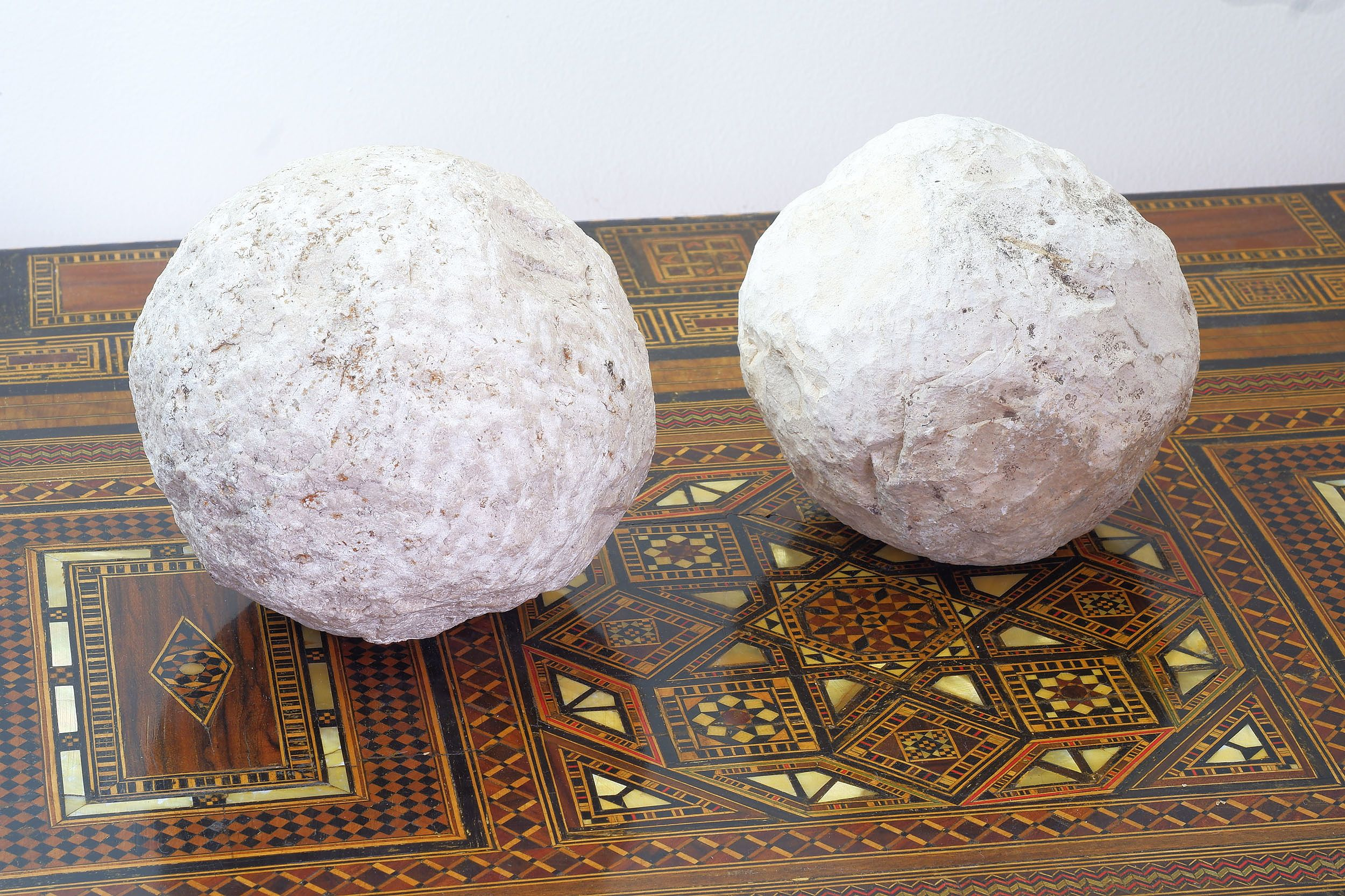 'Two Archaic Style Limestone Catapult Balls'