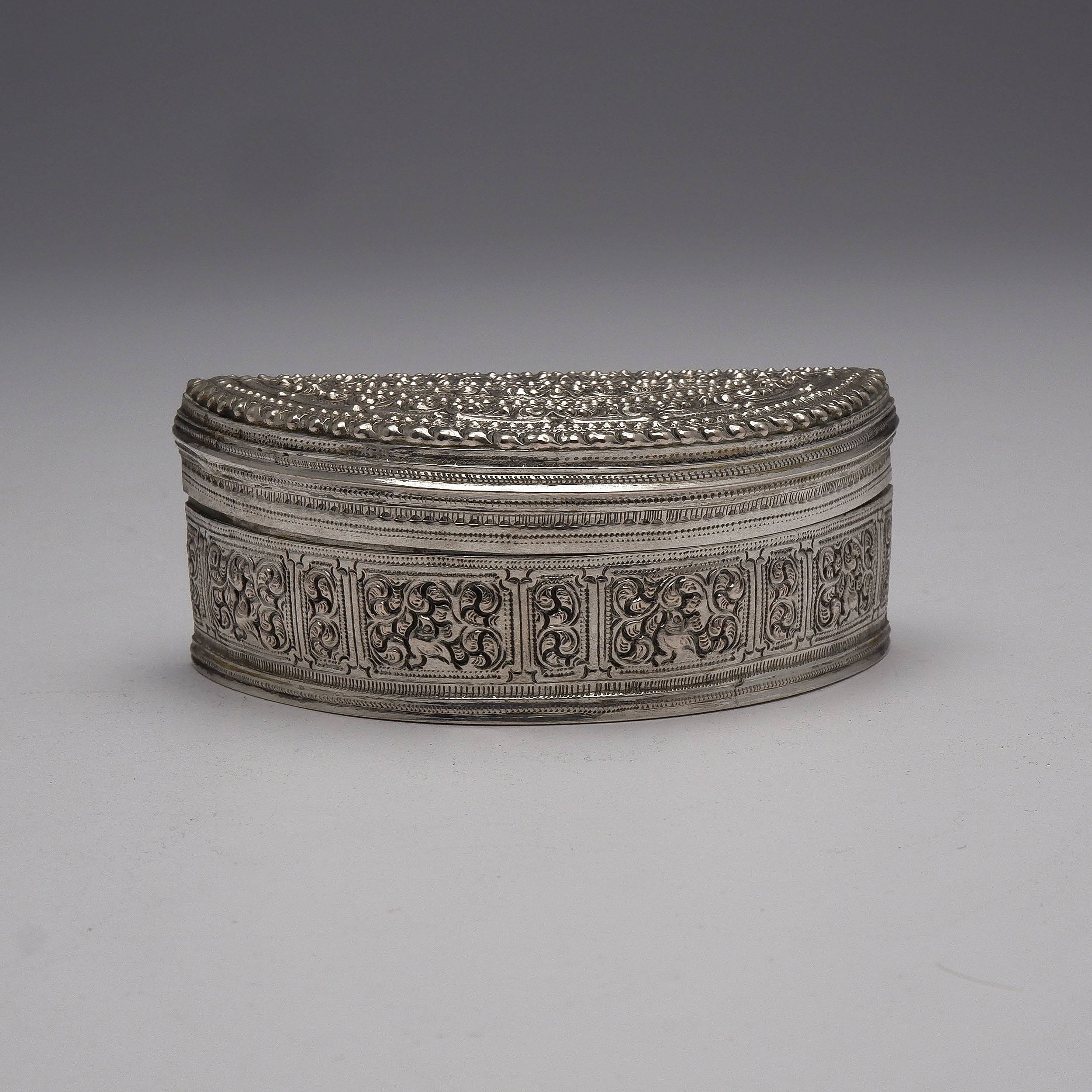 'Burmese Heavily Repousse and Engraved Silver Semicircular Box, 125g'