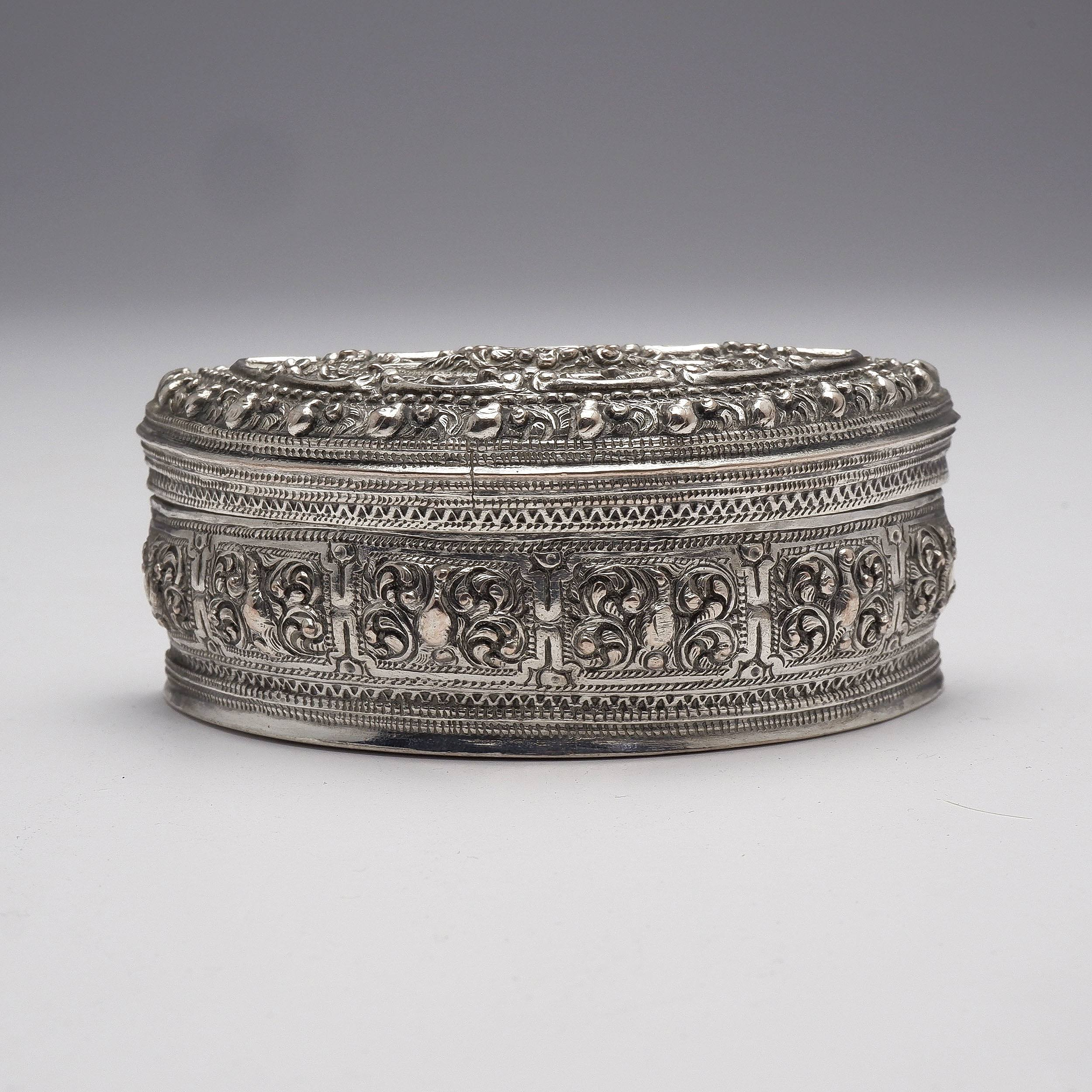 'Burmese Heavily Repousse and Engraved Silver Semicircular Box, 141g'