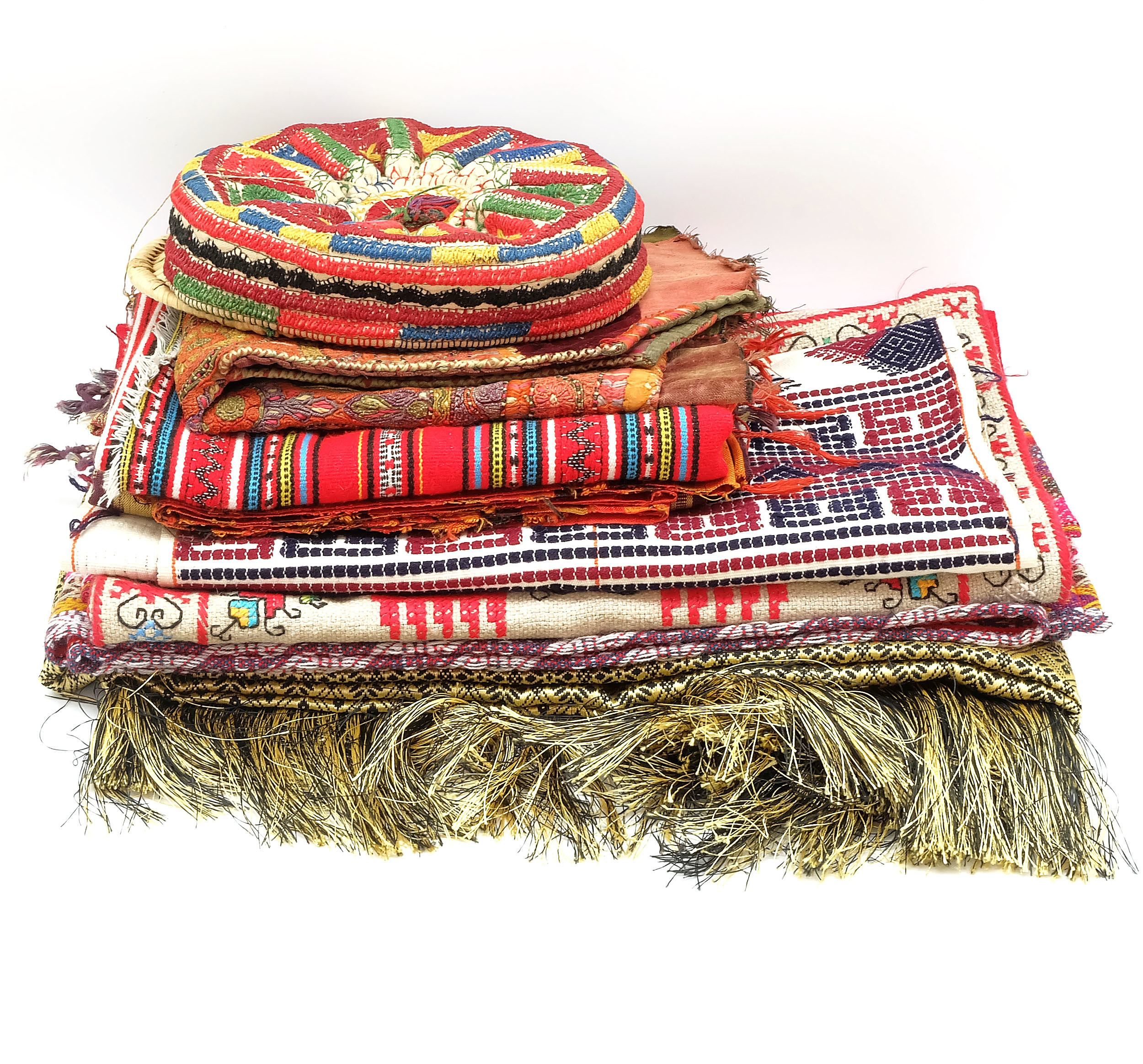'Group of Middled Eastern Textiles Including a Taqiyah  '