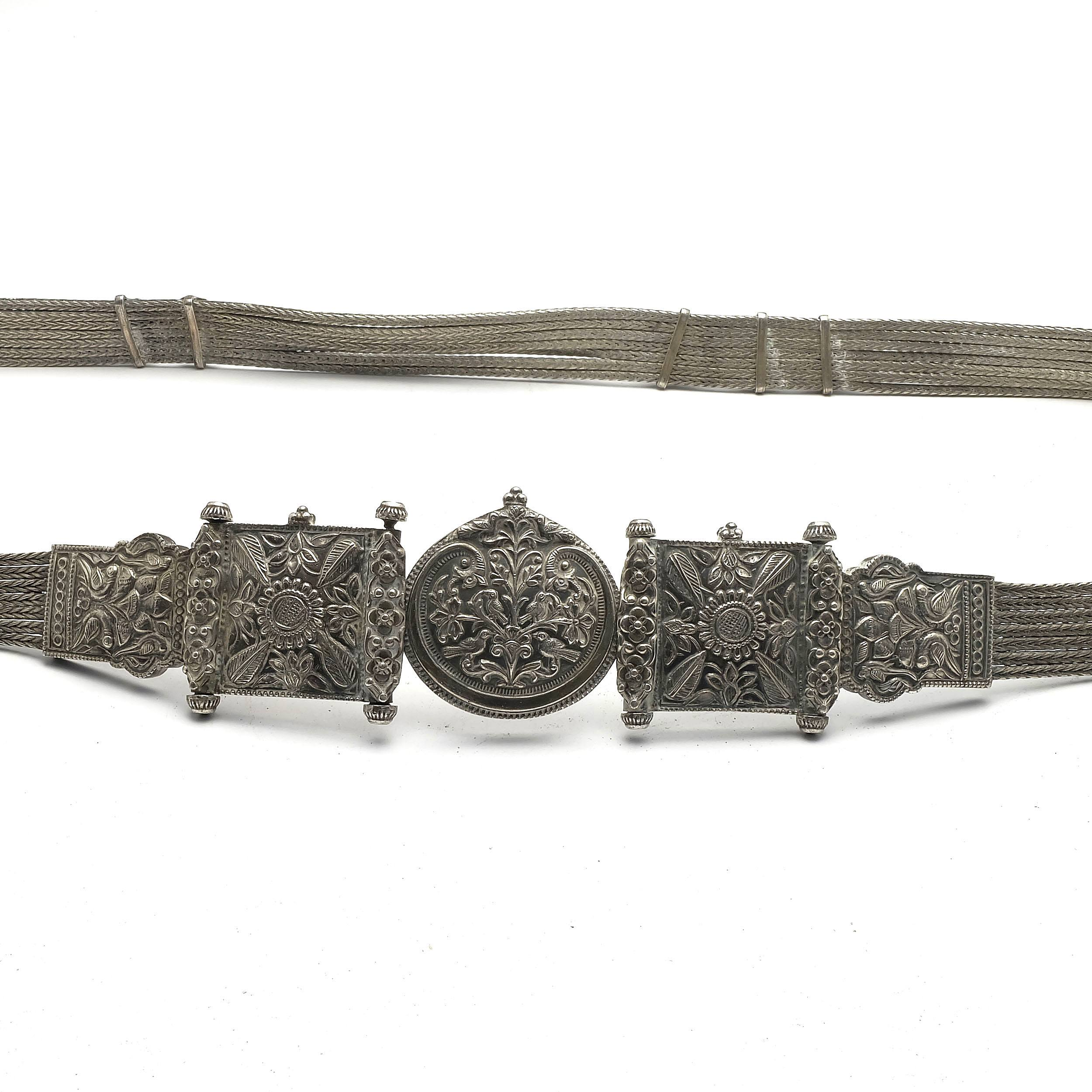 'Indian Silver Belt with Repousse Buckle and Seven Braided Silver Wires Forming the Belt, 385g'