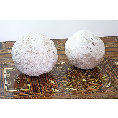 Two Archaic Style Limestone Catapult Balls