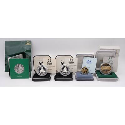 Two 1986 $10 Proof Coins, 1984 $1 Proof Coin First Year of Issue, 1988 $5 Proof Coins, 1988 Silver Uncirculated Coin
