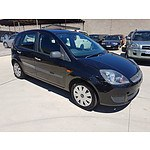 4/2006 Ford Fiesta LX WQ 5d Hatchback Black 1.6L