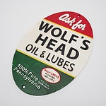 Wolf's Head Oil & Lubes Embossed Cast Iron Sign, Reproduction