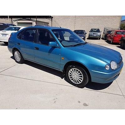 5/1999 Toyota Corolla Conquest SECA AE112R 5d Liftback Blue 1.8L