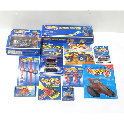 A Quantity of Hot Wheels Merchandise, Including HW Guides, HW Watches, HW Colouring Book and More