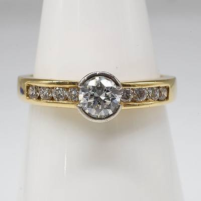 18ct Yellow Gold Ring with 0.30ct Round Brilliant Cut Diamond and Eight Round Brilliant Cut Diamonds