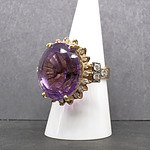 14ct Yellow Gold Ring with Large Oval Cut Amethyst and Thirty Two Round Brilliant Cut Diamonds Surround