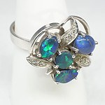 18ct White Gold and Platinum Ring With Four Cabochons of Black Opal and Eight Single Cut Diamonds