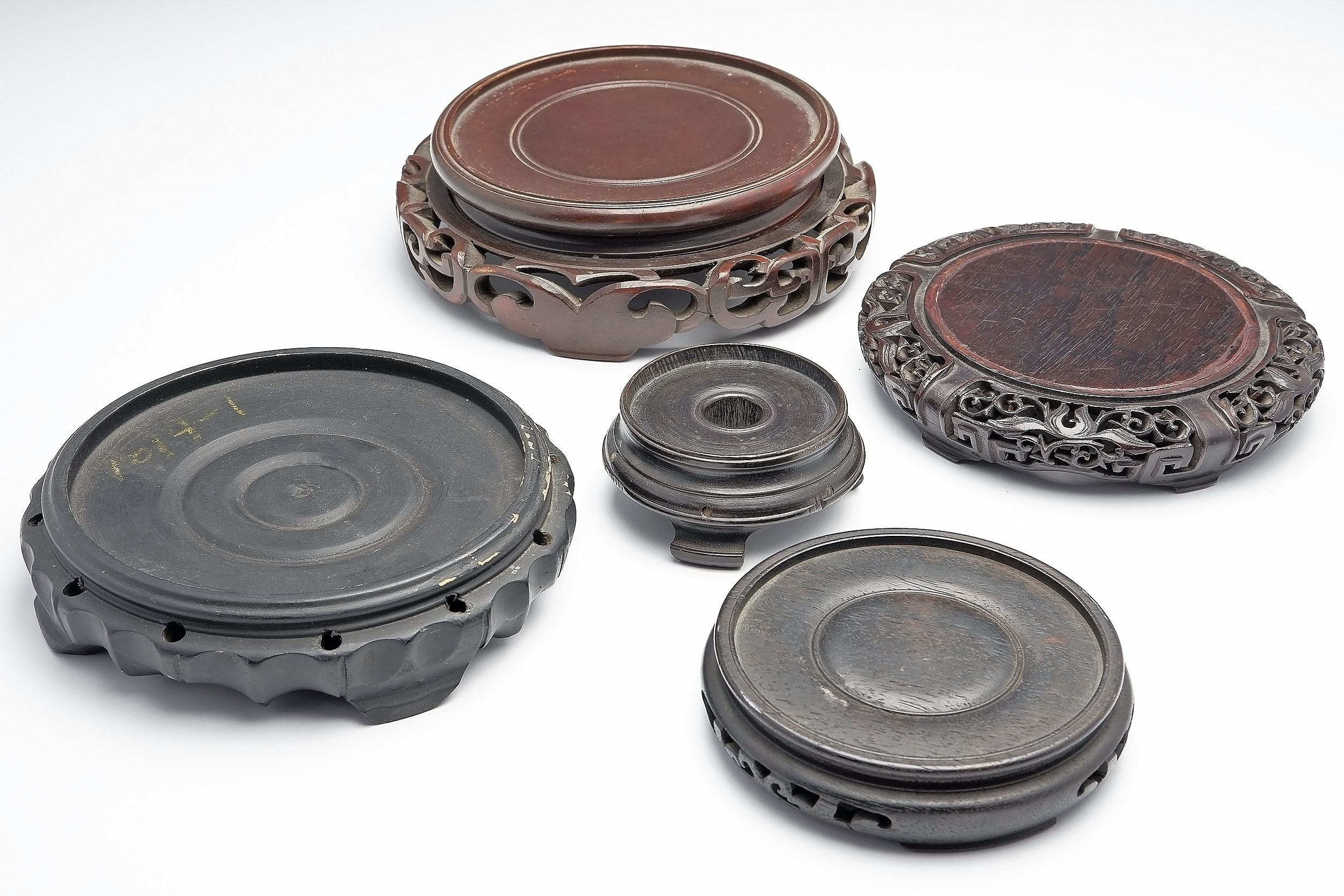 'Five Chinese Carved Hardwood Vase Stands'