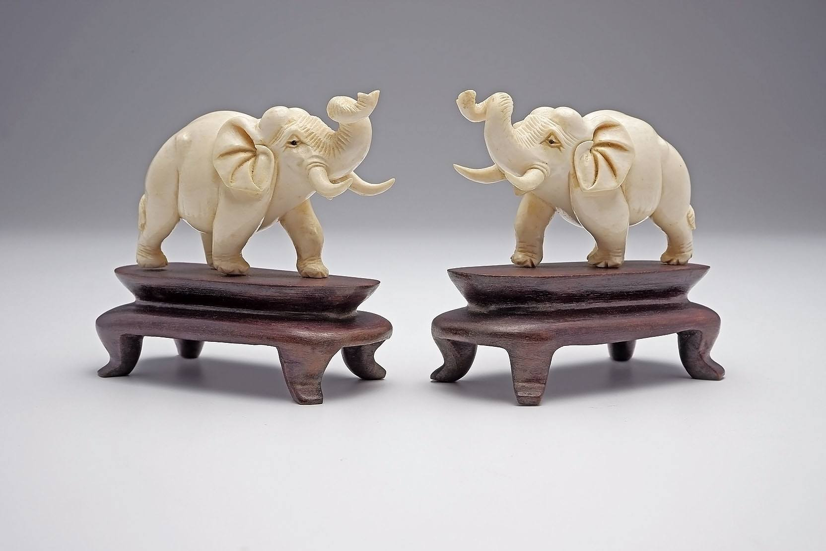 'Pair of Chinese Ivory Elephants on Caved Hardwood Stands, Mid 20th Century'