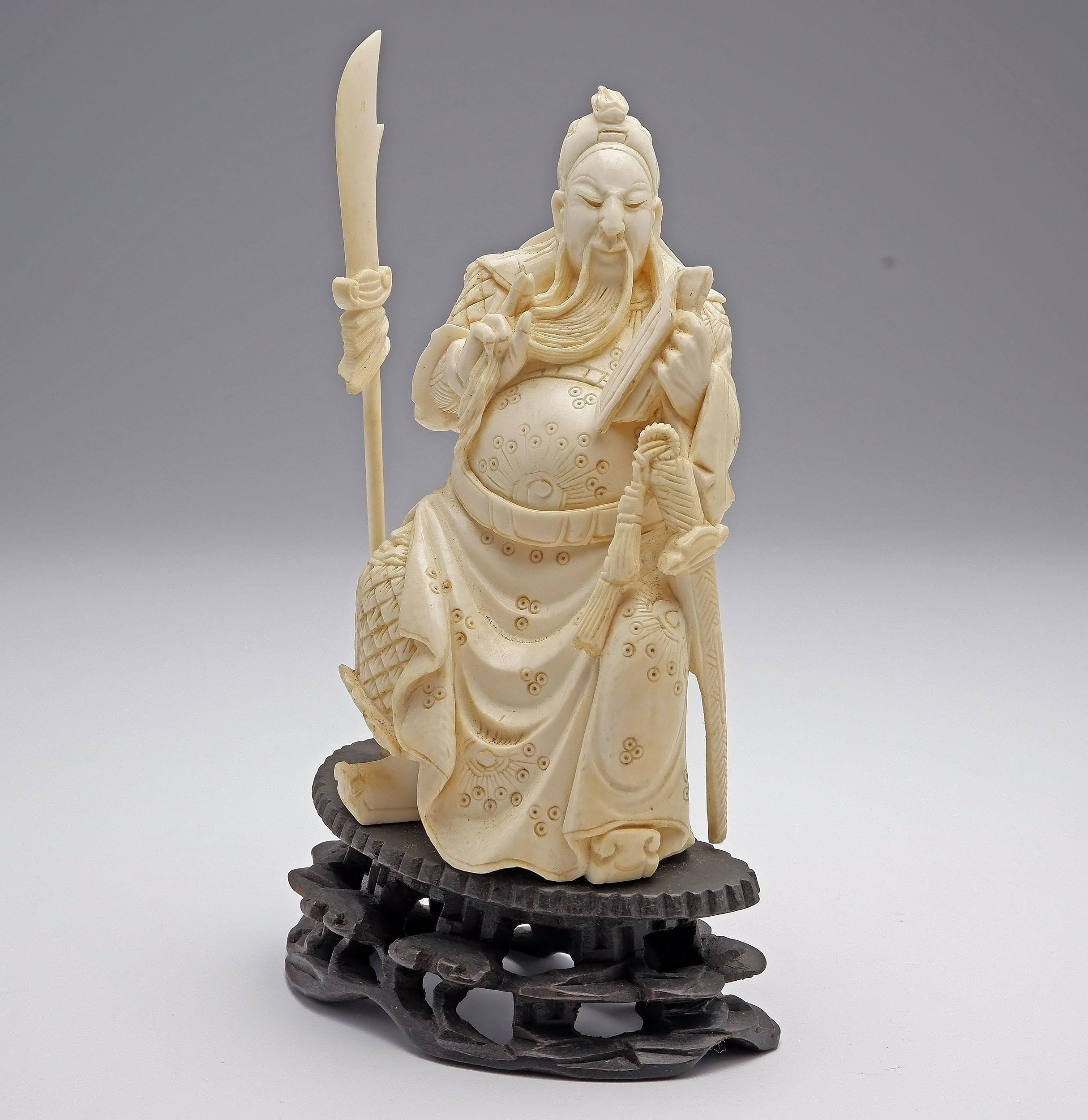 'Chinese Carved Ivory Model of a Warrior on Hardwood Stand, Early to Mid 20th Century'