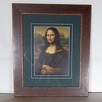 A Print of the Mona Lisa in Wooden Frame