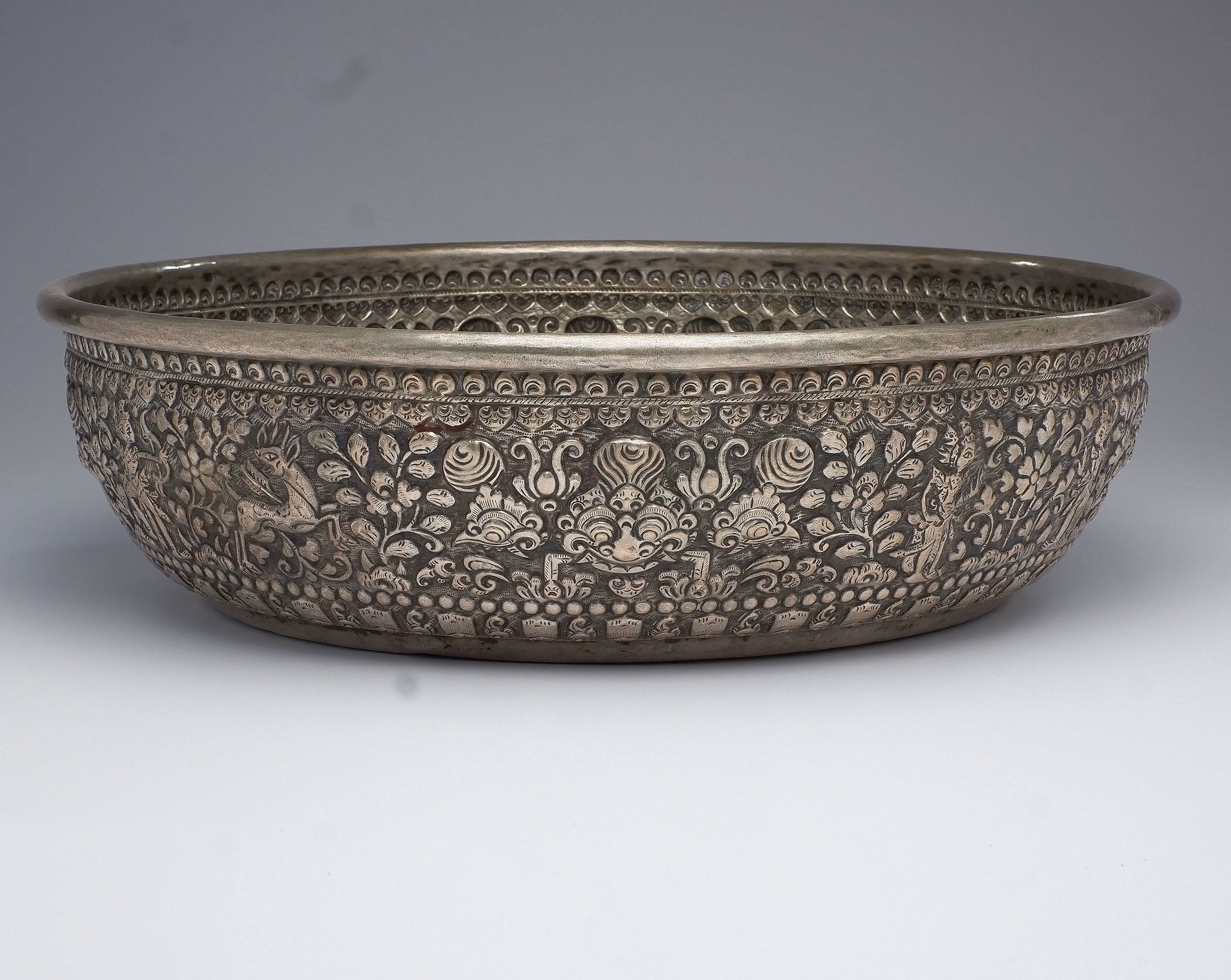 'Large Early Balinese Silvered Brass Offering Bowl Heavily Repousse Decorated with Animist Icons'