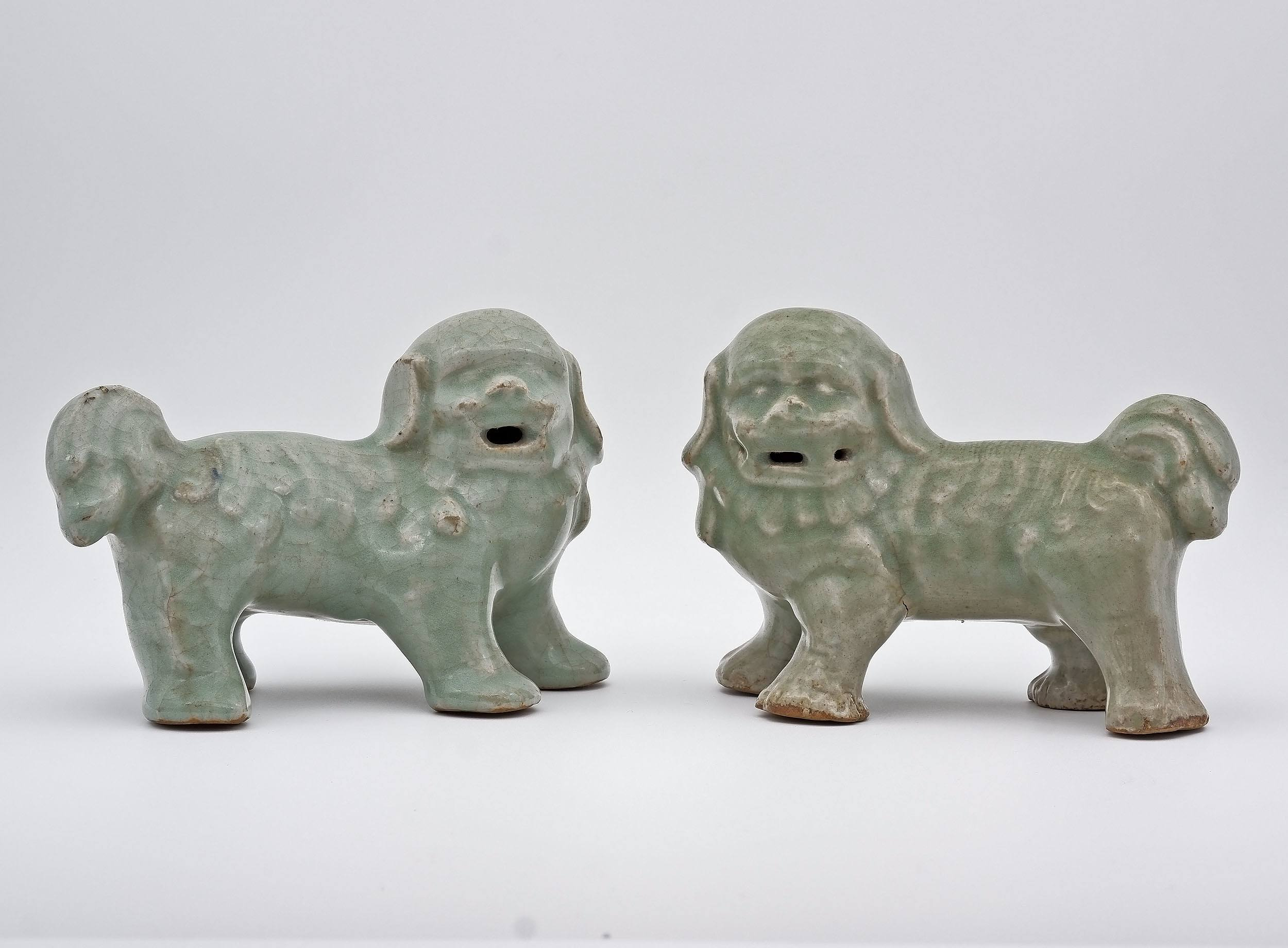 'Rare Pair of Chinese Longquan Celadon Buddhist Lions, Ming Dynasty'