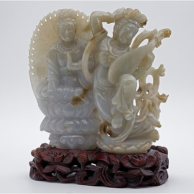 Fine Chinese Celadon and Russet Jade Figural Group of a Goddess Playing the Lute Flanked by a Bodhisattva Seated on a Lotus Base, 20th Century