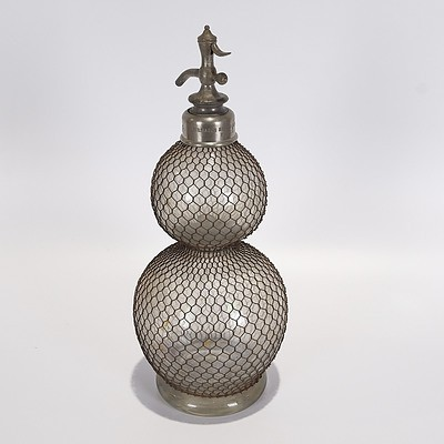 French Double-Ball Soda Syphon with Metal Wire Mesh Circa 1910. Imprinted 'Veritable Seltzogene D Fevre 5 Signed D Fevre Marque Deposee'