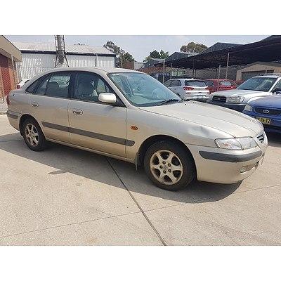 12/1999 Mazda 626 Classic  4d Sedan Gold 2.0L