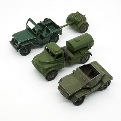 Four Vintage English Dinky Toys, 673 Scout Car, 643 Army Water Tanker, Jeep 25Y and Trailer 25 Pr Gun