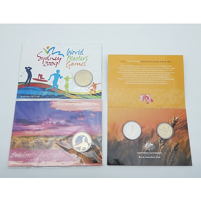 Three Uncirculated Coin Sets, Including 2012 Wheat - Fields of Gold, 2009 World Sydney Masters, and 2012 Celebrate Australia