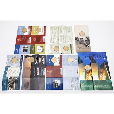 Twelve RAM Uncirculated One Dollar Military Themes Coins, Including 2003 Vietnam for Service, 2003 Korean War, 2001 Navy 90th Anniversary and More