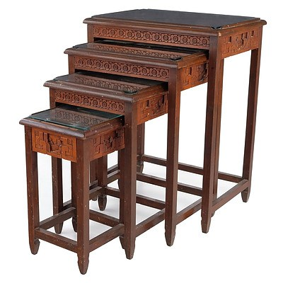 Set of Four Carved Chinese Teak and Glass Top Nesting Tables