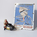 French Michelin Enamelled Tin Sign and a Cast Iron Michelin Novelty Figure, Modern