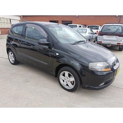 3/2006 Holden Barina  TK 3d Hatchback Black 1.6L