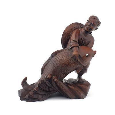 Chinese Hardwood Carving of A Fisherman and Carp with Inlaid Eyes