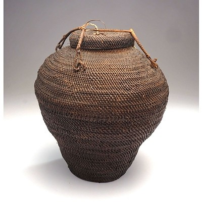 An Asian Wicker Basket with Lid