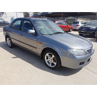 8/2003 Mazda 323 Protege  4d Sedan Grey 1.8L