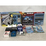 Group of Household Items Including Console Accessories and Model Construction Kits