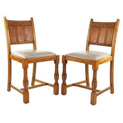 Four English Oak and Leather Upholstered Dining Chairs in the Tudor Style Circa 1930s