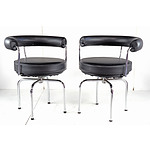 Pair of Australian Made Versions of LC7 Le Corbusier Swivel Armchairs with Black Leather Upholstery, Designed 1928 These Chairs Circa 1980