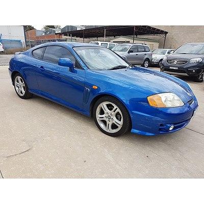5 2004 hyundai tiburon v6 2d coupe lot 1105996 allbids 5 2004 hyundai tiburon v6 2d coupe blue 2 7l