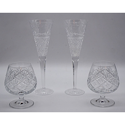 Two Doulton Cut Crystal Brandy Balloons and Two Stuart Crystal Champagne Flutes