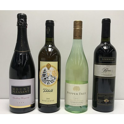 Four Bottles Of Red and Wite Wine
