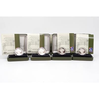 Four 1999 $1 Fine .999 Silver Proof Coins with Boxes