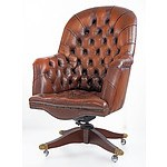Tan Leather Upholstered Deep Buttoned Chesterfield Style Swivel Armchair
