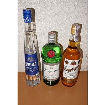 Three Various Bottles of Spirits