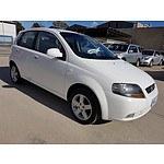 6/2006 Holden Barina  TK 5d Hatchback White 1.6L