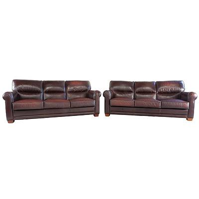 Pair of Moran Burgundy Leather Upholstered Lounges