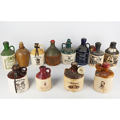 Group of Twelve Empty Port and Whiskey Stoneware Decanters