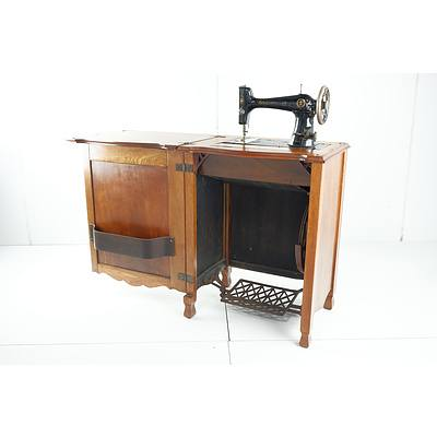 Vintage Oak Sewing Machine Cabinet with New Century Ace Sewing Machine