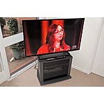 Panasonic TH-42A400A 42 Inch TV, LG DVD Player, TV Stand and Various CDs