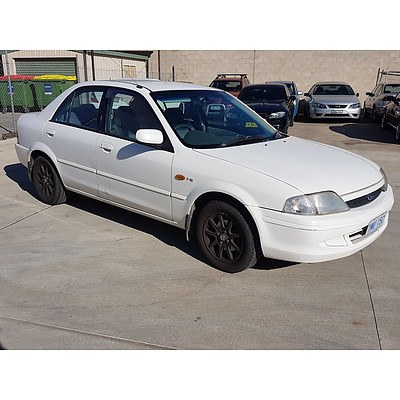 10/2000 Ford Laser GLXi KN 4d Sedan White 1.8L