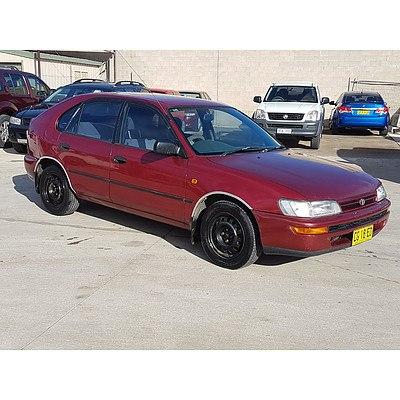 4/1996 Toyota Corolla CSi Spirit SECA AE101R 5d Liftback Red 1.6L
